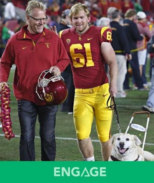 Photo by Engage LLC in Los Angeles Memorial Coliseum with @jakeolson61. May be an image of 2 people, people playing football and text.